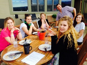 Host family and Maike gather for a family meal, al fresco style!