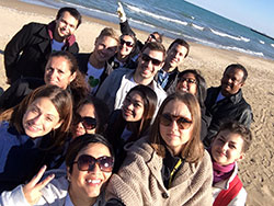 The JPAC volunteer group taking a selfie while cleaning up 57th Street Beach.