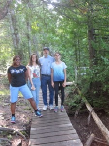 Host dad, Bob, goes for a hike with his daughter and students