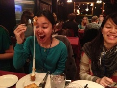 After participating on the student panel at CSIET in Milwaukee, Julie and her students joined Chicago Office Staff members at a local pizza joint. Here, Aoym enjoys her first mozzarella cheese stick.