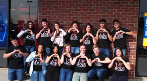 """Adrienne's students posing in their """"I 'heart' Mobile"""" t-shirts at a recent meeting."""