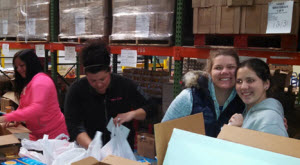 Having fun volunteering at a local food bank!