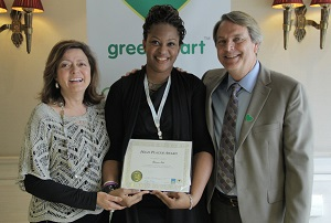 Adrienne Tate (LC) receiving her High Placer Award in Madrid, Spain with Laura Rose (CEO) and Emaneul Kuntzelman (President) of CCI Greenheart and Greenheart International