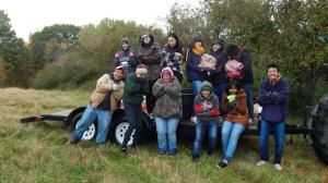 Lisa and her students at a cold and chilly apple picking volunteer event.