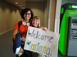 Lisa's daughter welcomes her exchange sister at the airport.