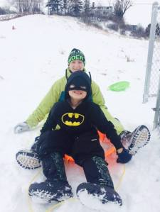 A bit of sledding fun for Ota and host brother, Braelyn