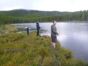 Hot dad,Doug, Ota, and Braelyn enjoying fishing in the Bighorn Mountains.